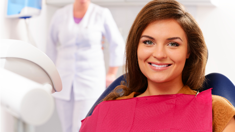 A Woman Smiles in A Dentist's Chair | Monroe, MI Dentist