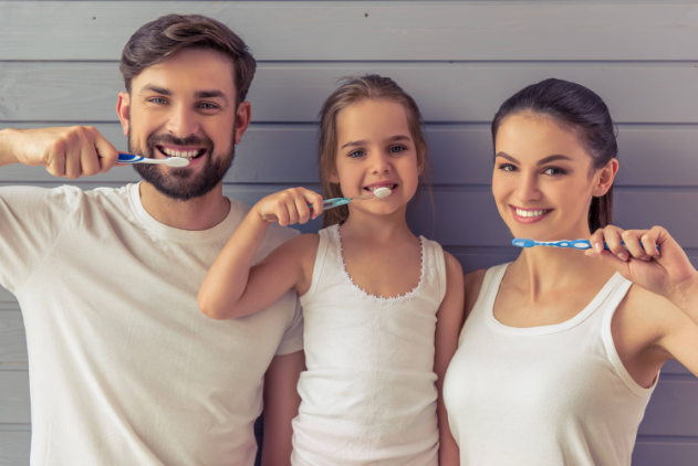 Mom Dad & Daughter Brushing Their Teeth